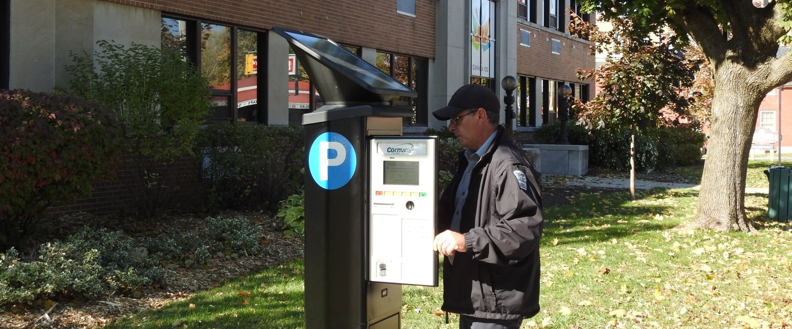 cornwall Parking clerk inspects pay and display machine