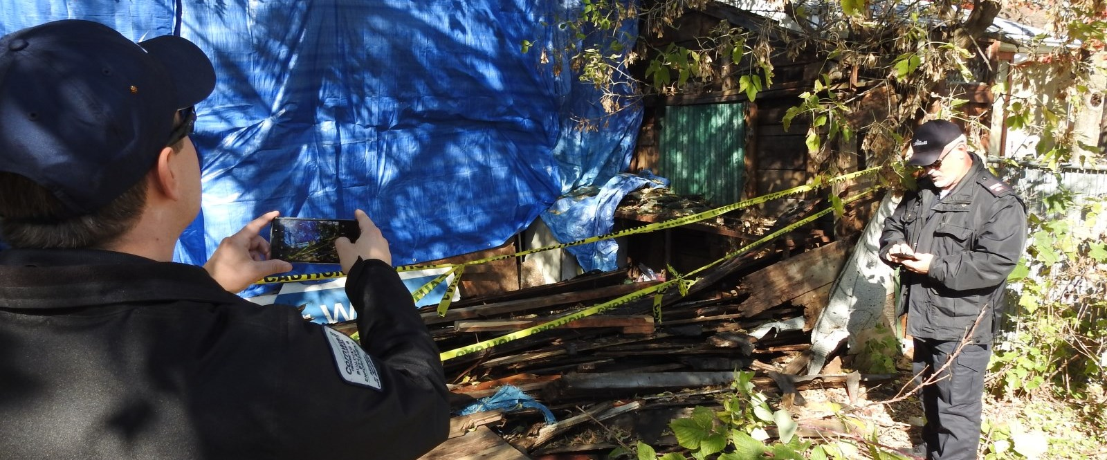 Inspectors look at home with blue tarp in backyard cornwall
