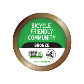 Green and bronze bicycle friendly community badge