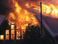 Large building with roof on fire
