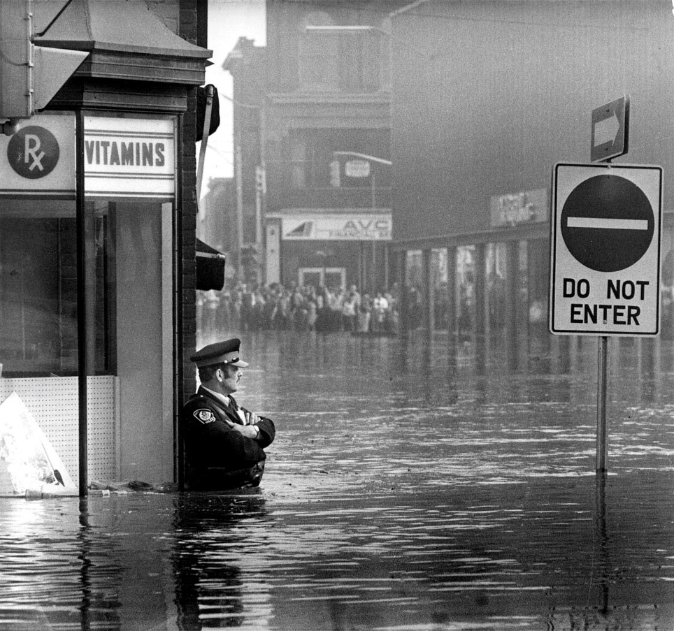 Police Officer standing in Floodwaters during the Cambridge 1974 Floods.