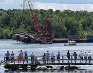 People watching salvage operation on St. Lawrence River