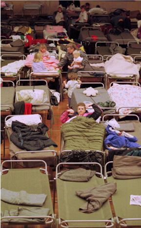 Image from an Evacuation Centre and people using emergency cots during an emergency