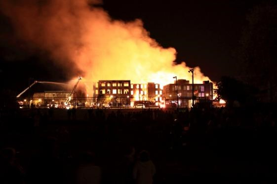 Cornwall Cotton Mills Fire showing mulitple buildings on fire, smoke and work to extinguish the fire