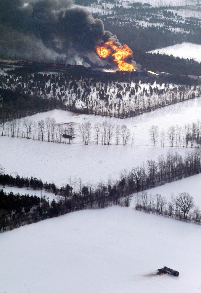 Aerial photo of train derailment in winter with heavy smoke