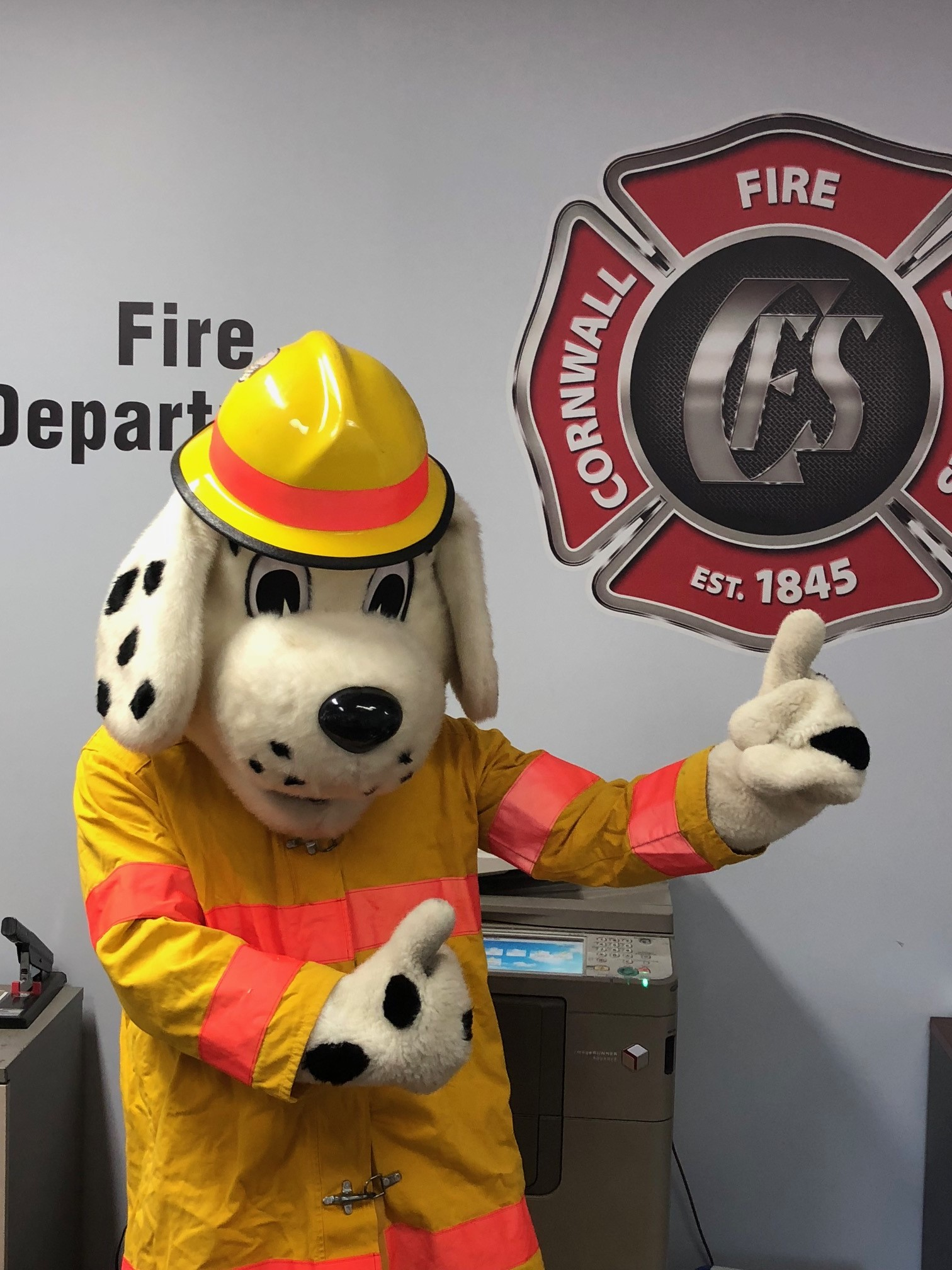 Sparky points to Cornwall Fire Services logo