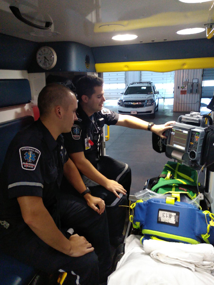 Newly hired paramedic is trained in back of ambulance