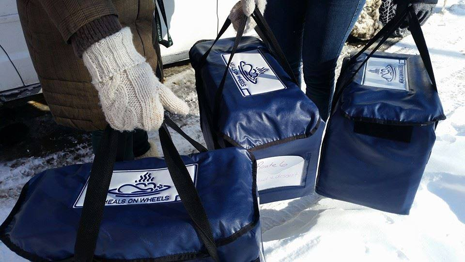 Volunteers deliver Meals on Wheels with warm jackets in the winter