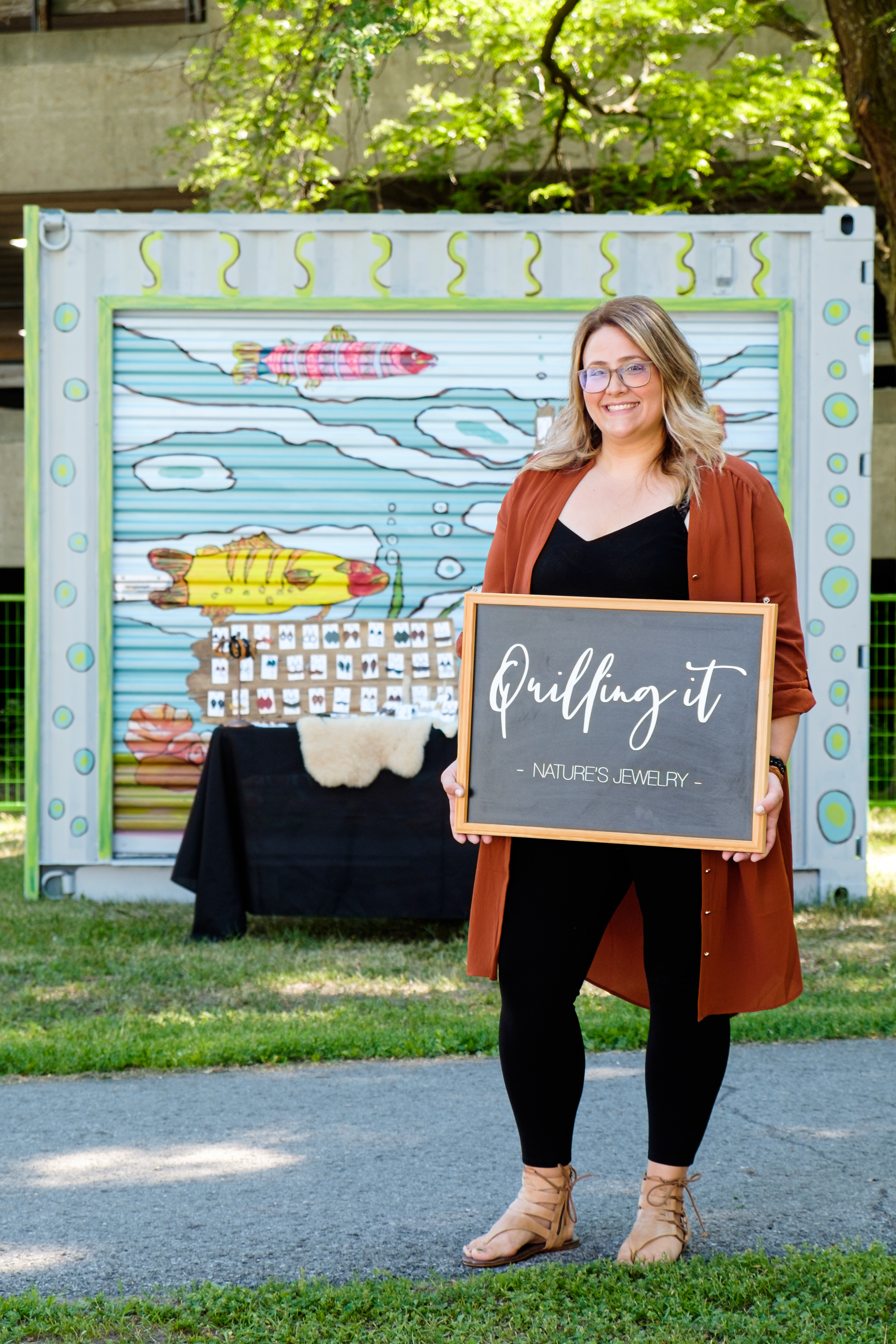 quilling it sign with owner at pop-up shop