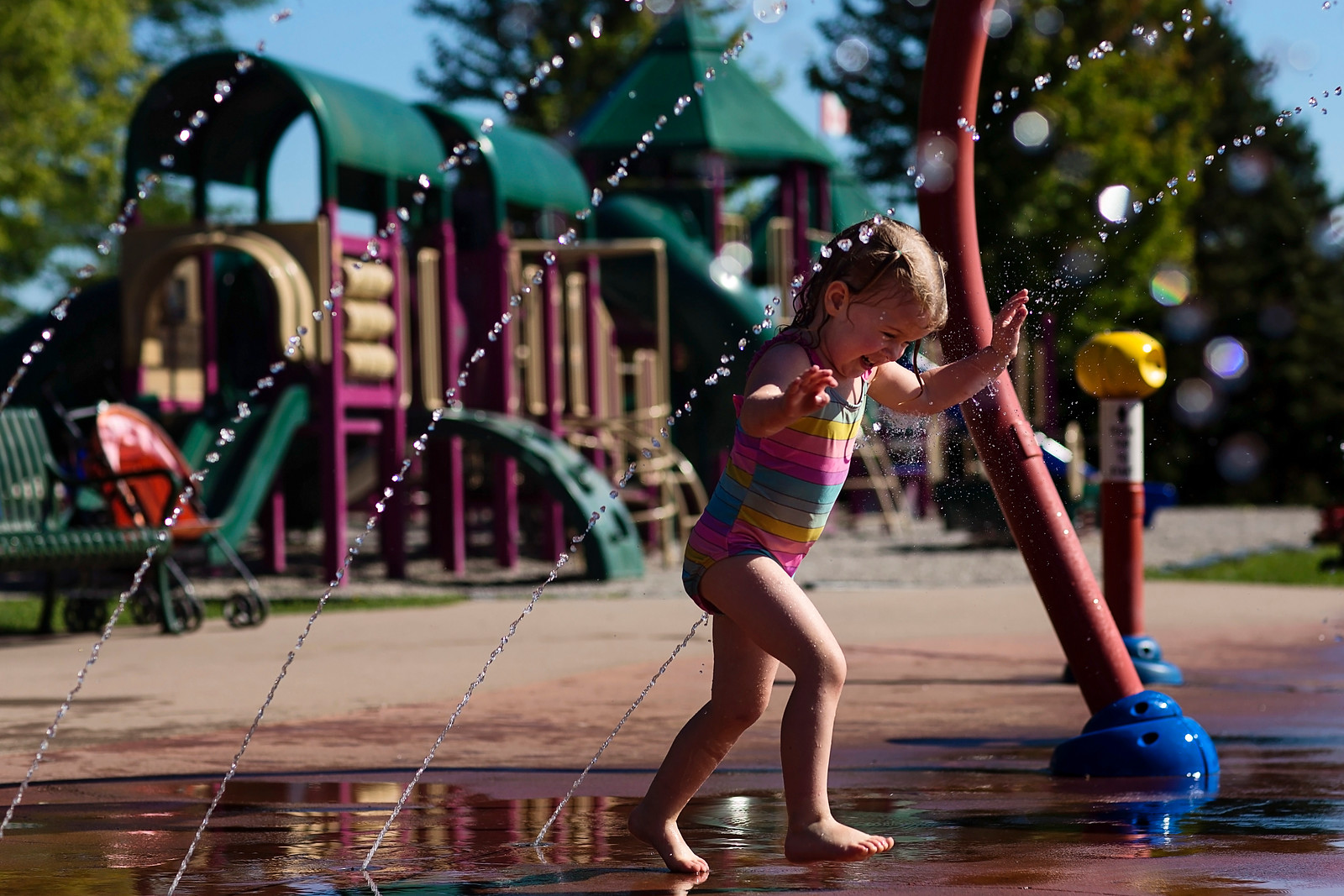 Child playing in splash pad