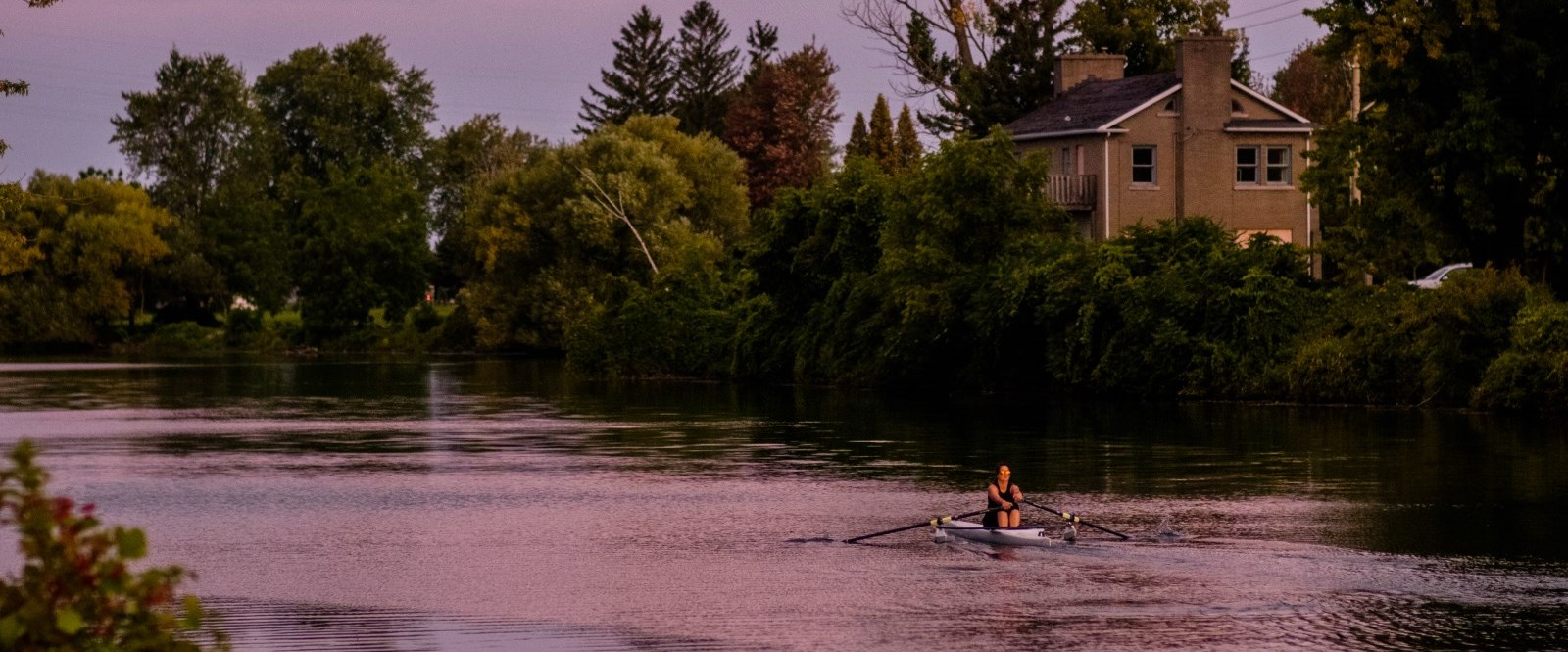 Rower on Cornwall Canal in sunset