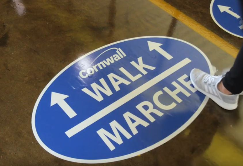 walk/march sign on floor of civic complex