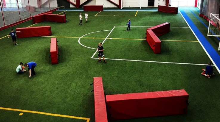 Children play Nerf battle in fieldhouse