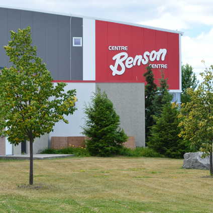 Outside view of Benson Centre, building is grey, red and white