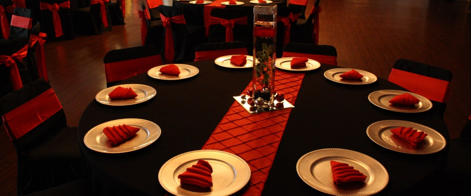 Tables covered in red and black decorations in cornwall meeting rooms