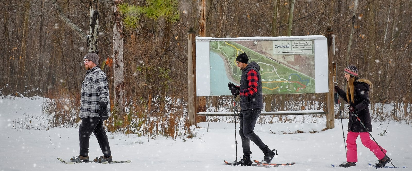 snowshoers passing by Guindon Park trail map