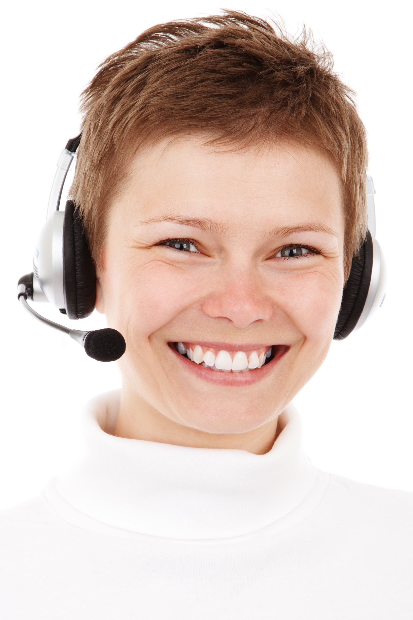 Woman smiling with headset in front of white background